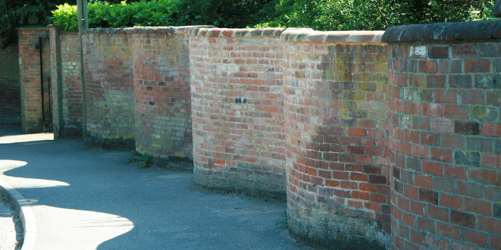 this quirky wall is old-school practical - it uses just one layer of bricks but is stronger than a straight wall